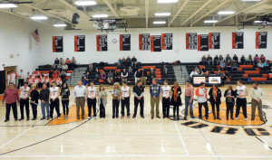 Bobcat Seniors with parents at recognition ceremony
