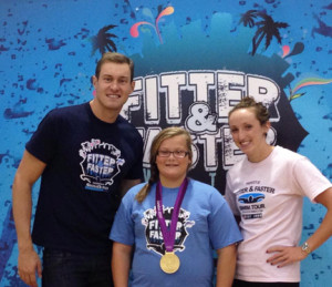 (Photo by Michelle Murray) Alayna Murray (center) with Peter Vanderkaay and Claire Donahue. Alayna is wearing Donahue's Gold Medal from the 2012 Olympics.