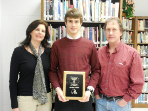 Clarion Area's Western Pennsylvania Football Conference Scholar Athlete Award winner Antonio Troese with his parents Jan and Rick Troese