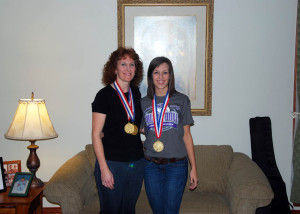(Photo by Chris Rossetti) Jodi and Ellie Burns proudly display Gold Medals