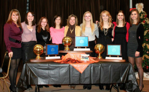 Gretchen with Coach Campbell and other seniors with trophies from last three State Finals