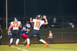 (Photo by Bri Nellis – brinellisphotography.shutterfly.com) John Katis throws a touchdown pass to Cody Hearst and captures the record to be Clarion's all-time leading passer.