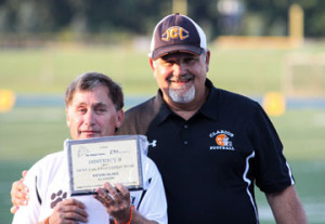 (Photo by Bri Nellis) Kevin, with Coach Wiser, proudly displays his award
