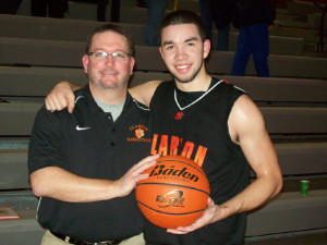 Roland Shannonhouse and Coach Smith with 1,000th point ball