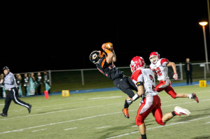 (Photo by Bri Nellis – brinellisphotography.shutterfly.com)Damien Slike makes a leaping catch from John Katis.