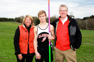 (Photo by G. Chad Thomas) Cody with his parents, Christine and Bill Hearst. An all-around athlete, Cody also participated in track and field and basketball.