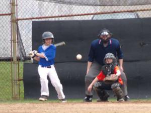 (Photo by Monica Goheen) Lake Staub puts the ball in play