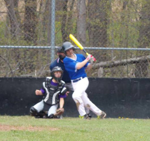 (Photo by Monica Goheen) Skylar Rhoades turns on a pitch