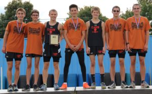 (Photos by Mark Bettwy) Winning Bobcat Boys' team atop the podium