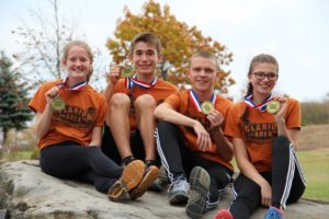 (Photo by Mark Bettwy) Bobcat Cross Country 2016 State Qualifiers (L-R) Chelsea Mason, Nathaniel Lerch, Adam Bettwy and Katie Craig