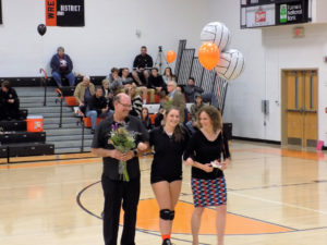 Olivia Burns with her parents on Senior Night