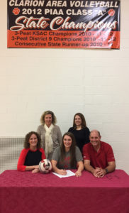 (Photo submitted by Clarion Area Volleyball) Olivia Burns seated with parents Jodi and Joe Burns. Clarion Head Coach Shari Campbell and longtime Assistant Coach Erika Cathcart.