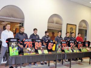 Bobcat Seniors with jerseys and photo awards